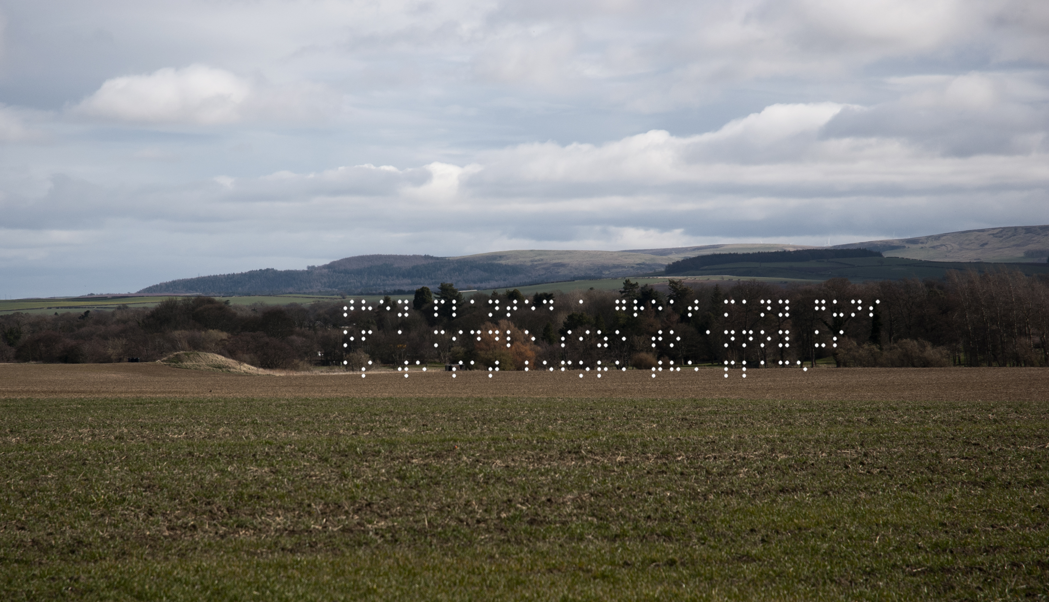 Farmed field with mound of earth. Mound was cannon platfrom. Quote taken from historical figure shown in Braille