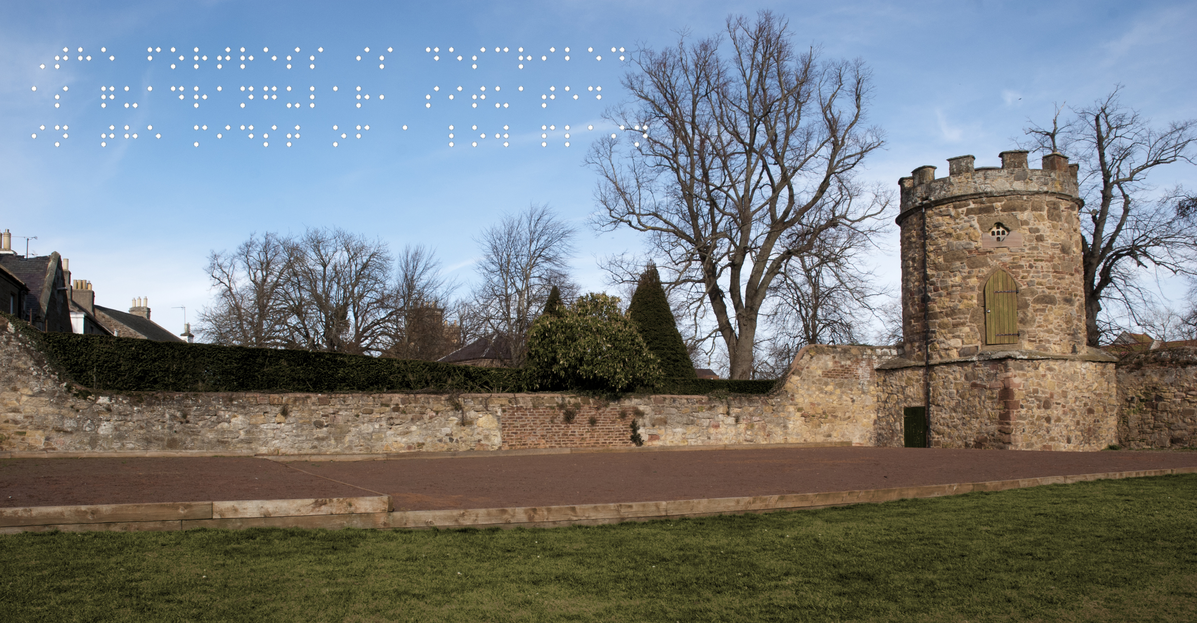 Victorian recreation of siege wall and tower. Quote taken from historical figure shown in Braille