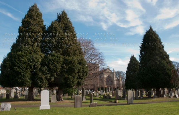 Foreground graveyard. Behind the trees is St Marys Church, all under a blue sky. Quote taken from historical figure shown in Braille