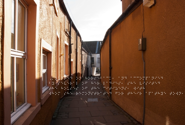 Orange walls of a close. Quote taken from historical figure shown in Braille
